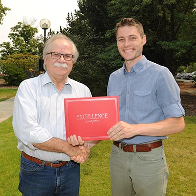 Daniel Haley receives award from Dean Slinker