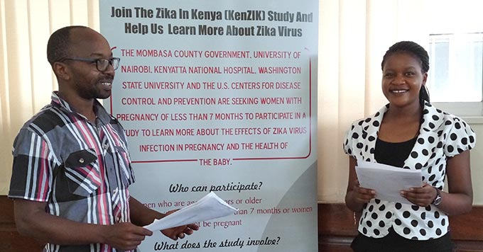 Deputy Director of Public Health for WSU Global HealthKenya Dr. Eric Osoro (left) with field study coordinator Harriet Mireiri reviewing study procedures at the Bomu Hospital in Mombasa, Kenya.